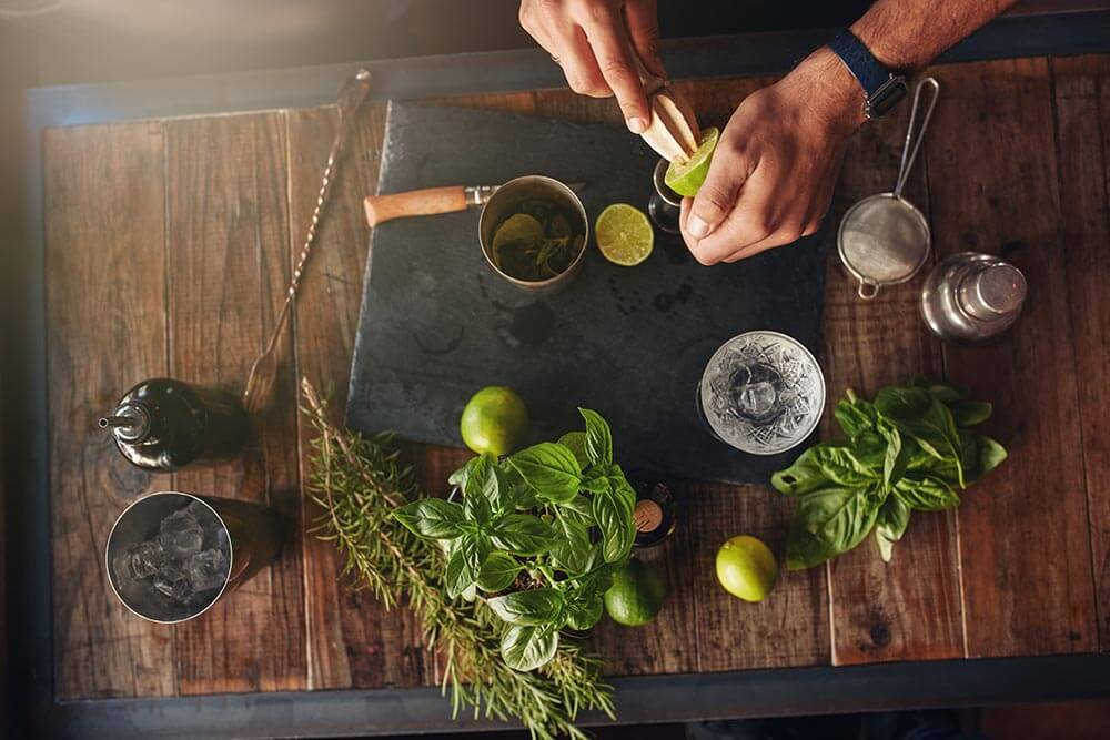lighthousetreatmentstock-insomnia-in-recovery-non-pharmaceutical-options-article-photo-bartender-hands-juicing-lemon-with-a-reamer-bartender-experimenting-with-creating-new-cocktails-439172758