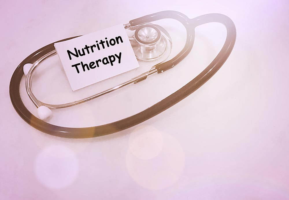 lighthousetreatment-importance-of-proper-nutrition-in-recovery-photo-nutrition-therapy-text-with-stethoscopes-pink-background-and-flare-559662067