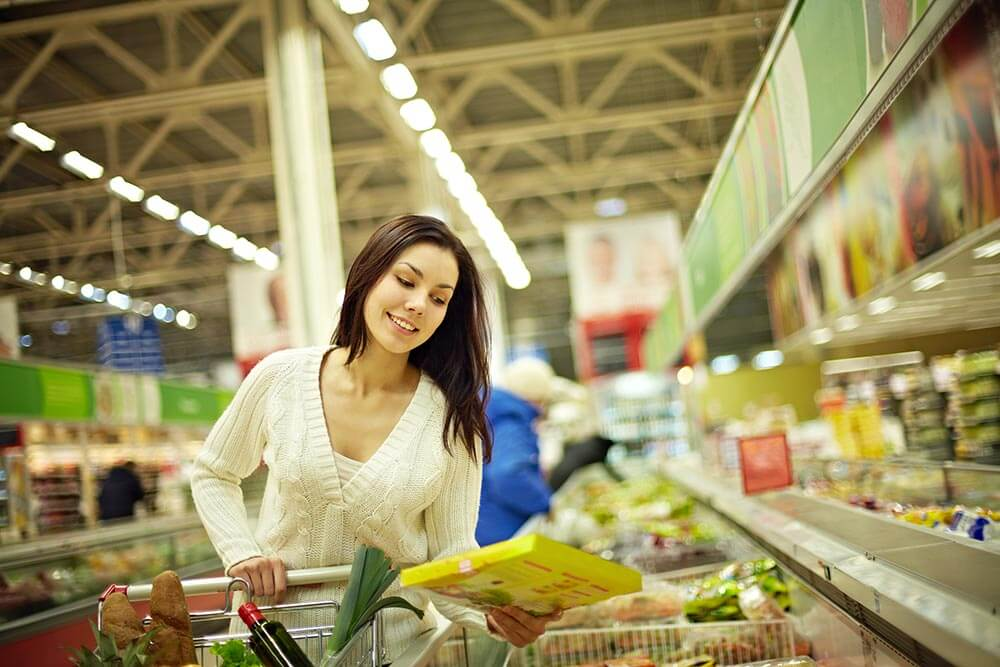 lighthousetreatment-importance-of-proper-nutrition-in-recovery-photo-woman-in-supermarket-525209701