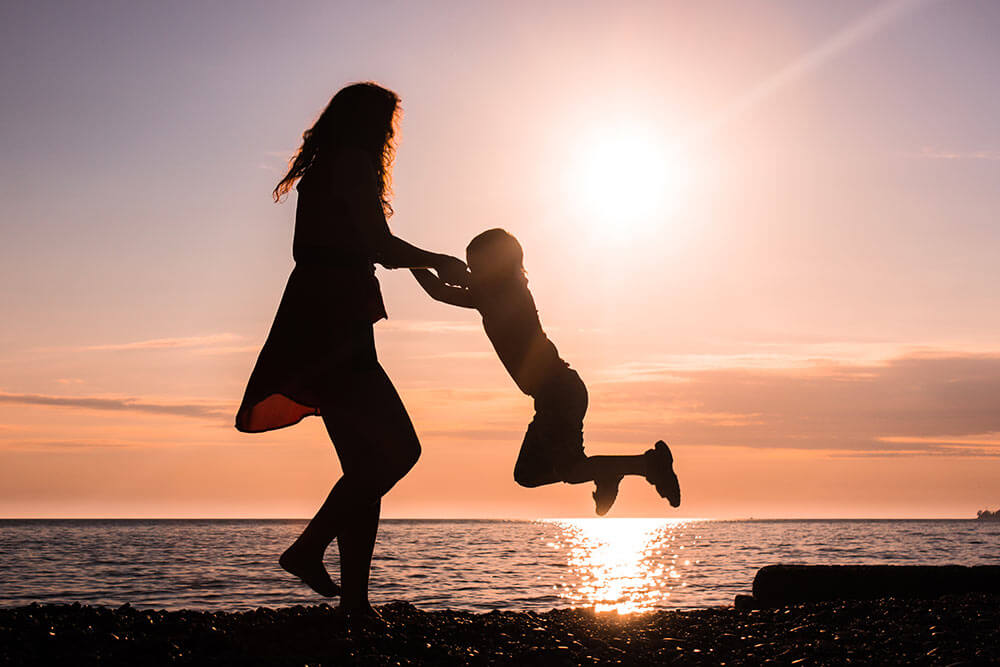 lighthousetreatment-5-appealing-rehab-features-for-single-parents-article-photo-silhouettes-dance-with-the-sun-graceful-girl-dancing-with-her-son-649139644