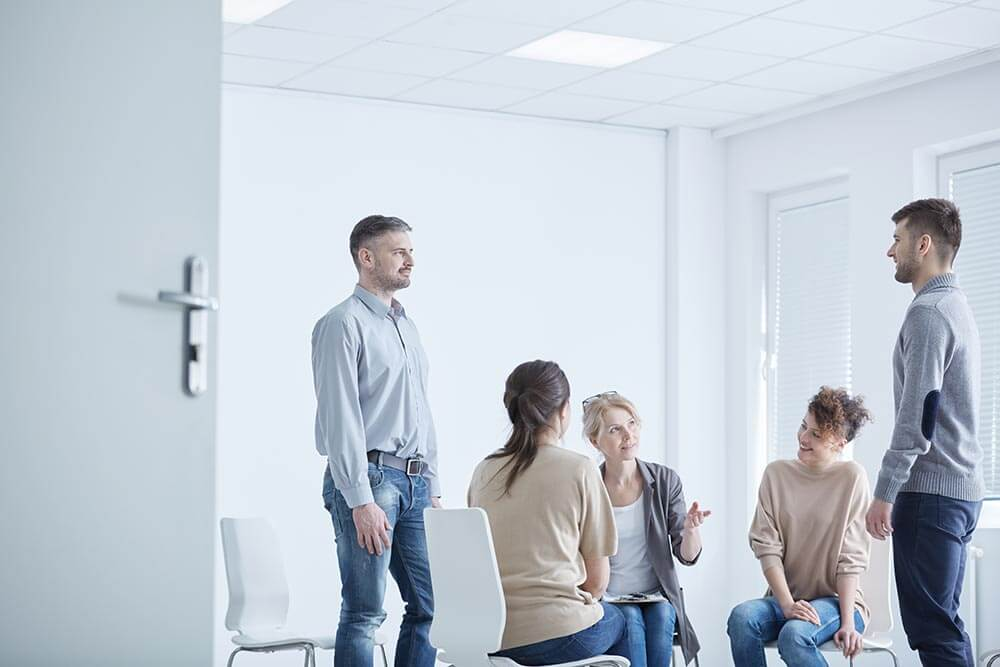 lighthousetreatment-can-i-treat-my-bipolar-disorder-with-marijuana-article-photo-two-men-confrontation-on-a-group-psychotherapy-with-psychologist-637116868