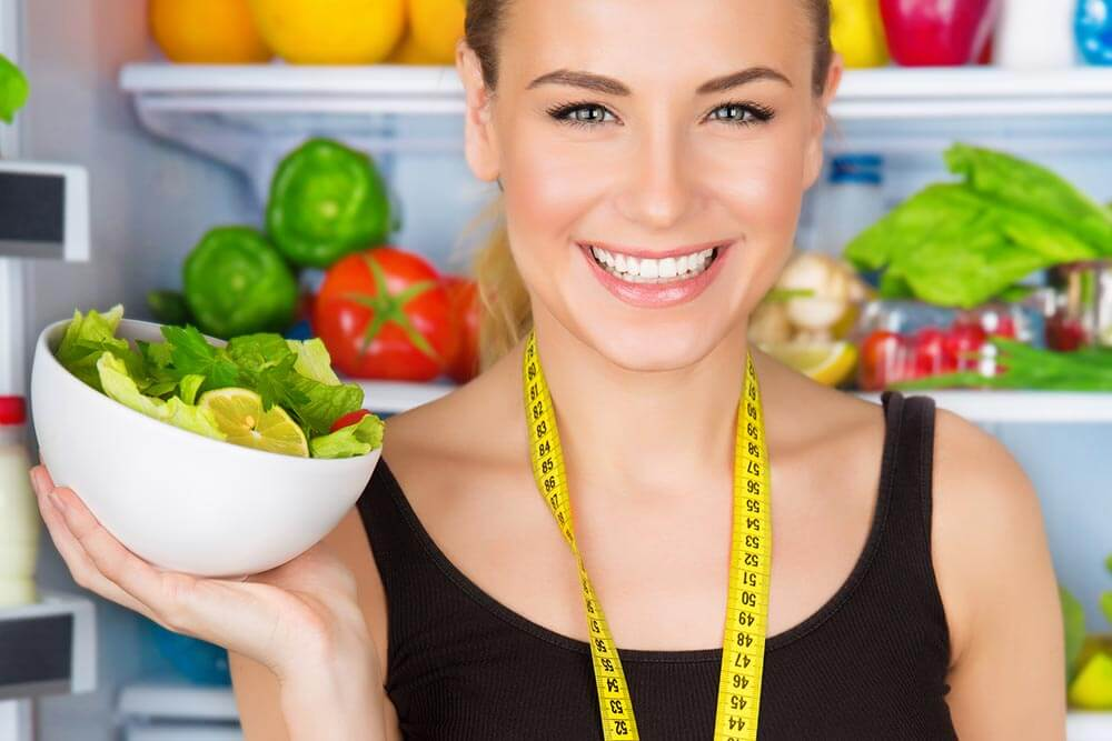 lighthousetreatment-7-tips-for-staying-clean-and-sober-article-photo-closeup-portrait-of-beautiful-cheerful-girl-holding-in-hand-bowl-with-fresh-tasty-green-salad-184504925