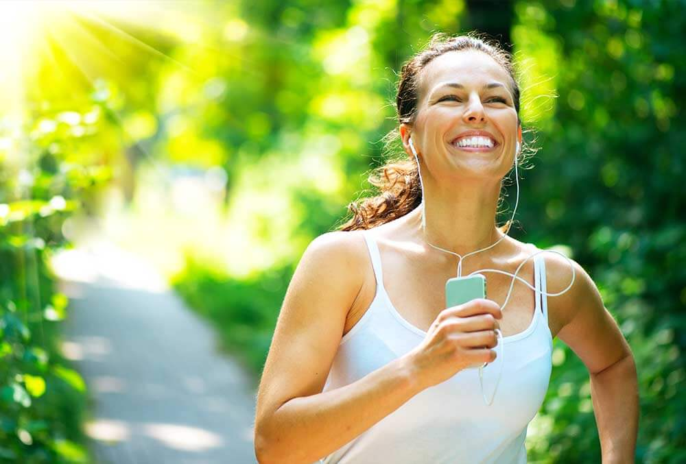 lighthousetreatment-7-tips-for-staying-clean-and-sober-article-photo-running-woman-female-runner-jogging-during-outdoor-workout-in-a-park-beautiful-fit-girl-fitness-177017162