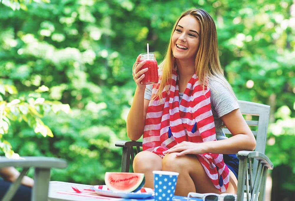 lighthousetreatment-7-ways-to-stay-sober-over-the-4th-of-july-article-photo-american-girl-hanging-out-on-the-fourth-of-july-in-her-backyard-658707184