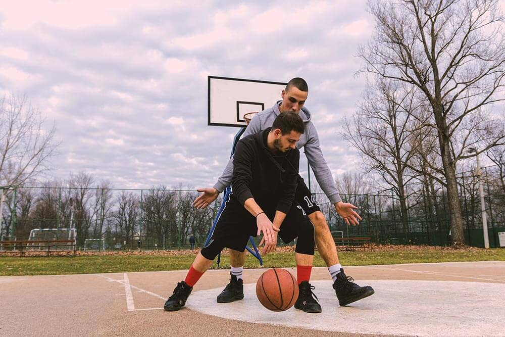 lighthousetreatment-9-ways-to-cope-with-anxiety-without-medication-article-photo-portrait-of-a-two-young-sports-men-playing-basketball-at-the-playground-summer-vacation-sport-789327679