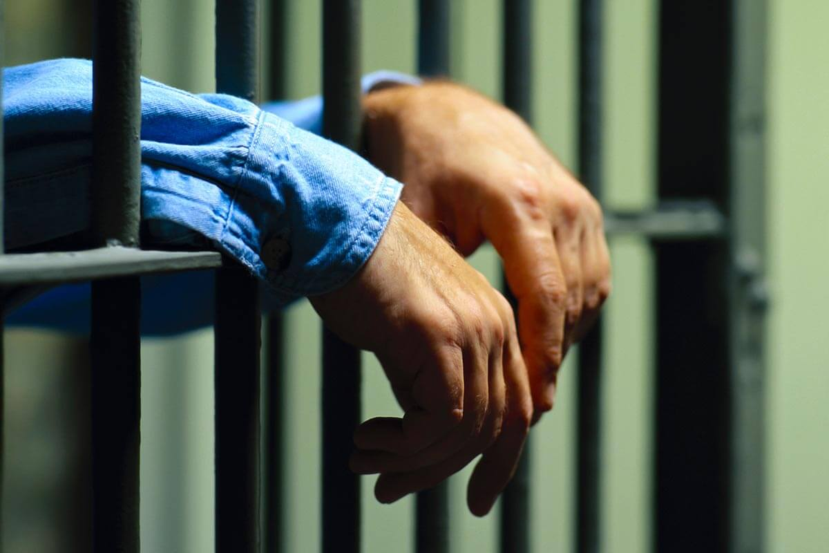 lighthousetreatment-does-imprisoning-drug-offenders-impact-drug-use-photo-arrested-man-in-handcuffs-with-hands-571729324