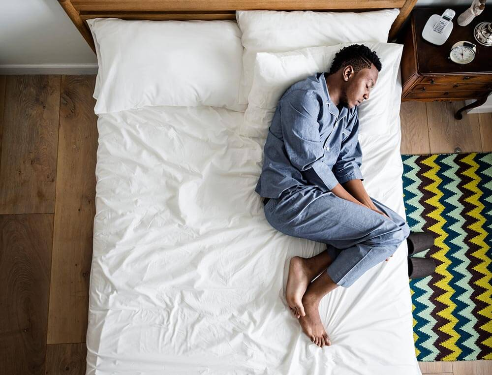 lighthousetreatment-a-complete-history-of-crack-cocaine-article-photo-lonely-man-sleeping-alone-on-the-bed-1017555658