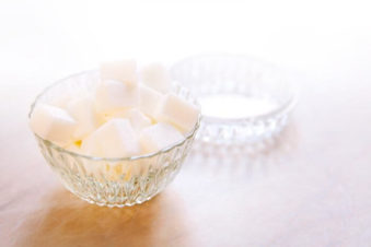 lighthousetreatment-what-should-i-know-about-using-sugar-in-early-recovery-photo-glass-sugar-bowl-with-white-pieces-of-sugar-on-the-table-with-blur-and-contour-soft-vanilla-color-1094806295